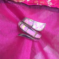 """Sterling Pink Opal Bypass Ring Bundle and save up to 30%! If you love pink, this ring is for you! Pretty man made pink opal shines with iridescent color changes, including gold flecks. Hard to capture in pictures. Hallmarked """"AK 925"""" SIZE 6, but since it's a wide band, size 5-5.5 could also wear. Like new! Jewelry Rings"""