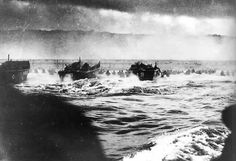 Photo of landing craft hitting the beach at Omaha on D-Day