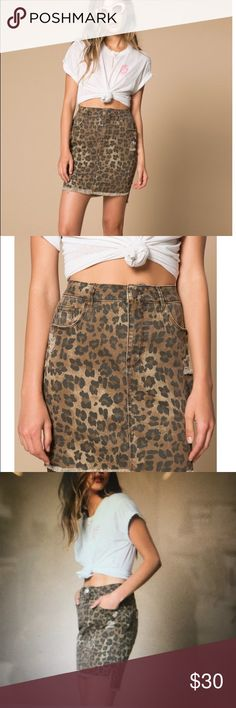 Arrive Leopard distressed denim skirt Leopard print, with a slight high-lo raw hem line. 99/1 Cotton Span. Arrive Skirts Mini