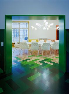 amazing colorful parquet flooring throughout this Swedish apartment