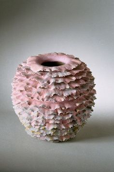 Sandra Davolio. Ceramic. I love the way this looks like a series of turkey-tail mushrooms.