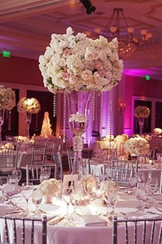 Amazing #floral #centerpiece at this #uplighting #wedding #reception! #diy #diywedding #weddingideas #weddinginspiration #ideas #inspiration #rentmywedding #celebration #weddingreception #party #weddingplanner #event #planning #dreamwedding via #junebugweddings