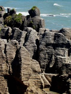 Pancake Rocks Punakaiki, West Coast, South Island, New Zealand.  The limestone rock formations resemble layers of pancakes.