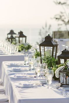 Gorgeous lantern and floral centerpieces for a seaside wedding #beach #coastal #wedding