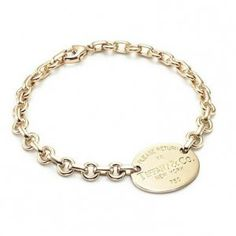 Return to Tiffany & Co Oval Tag Gold Bracelet
