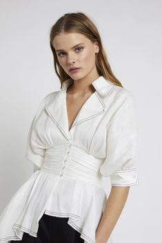 The Whitehaven Blouse is a white statement blouse with an extended curved high-low hemline. Trench style collar, blouson sleeve and buttoned cuffs. Shirred panel at back waistband for ease of fit. The New Classic, Hemline, High Low, Fitness Models, Ruffle Blouse, Tunic Tops, Sleeves, How To Wear, Shopping