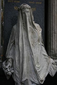 Beautifully draped sculpture at cemetary