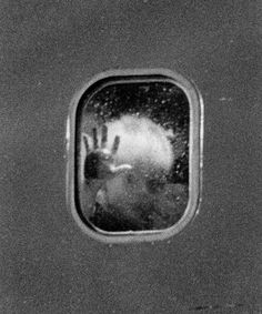 Airline Passengers Photographed Through the Window