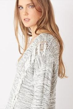 Fringe sweaters are so in style. Grab one while they're hot!