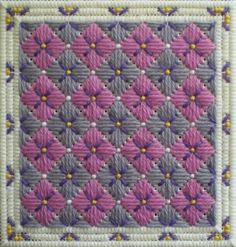 Stitch a lovely bunch of needlepoint hydrangea blossoms in long stitch using this free pattern or chart.