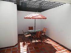 Backyard canopy on pinterest cheap patio ideas patio for Toldos para patios pequenos