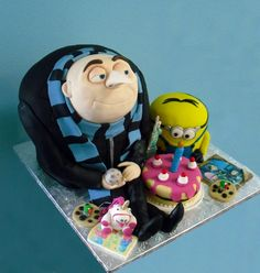 Despicable me birthday cake.  Look at the amazing amount of detail in this cake.  There's a moon, a shrunken Statue of Liberty, some cookie robots, a photo of the girls, a unicorn, and the sleepy kittens book.  This is really amazing.