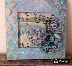 A mini frame designed using IndigoBlu paints, stencil and Altered Egos with clear texture paste
