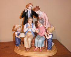 .   Denim days Home Interior family figurine, new in box.