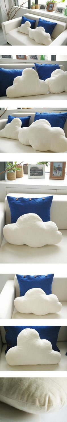 The cloud pillows would also go great with rainbow striped pillows if a blue pillow was not complimentary to the color of your sofa