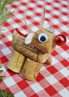 X-mas Dinner place bard holders!  Wine Cork Projects- This little Red Nosed Reindeer is made from two and a half corks, some fabric scraps for his tail and ears, a tiny piece of jute for antlers and the red nose is a bead off that Dollar Store ornament I took apart for the previous ornament.