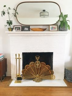 An amazing vintage brass fireplace screen in the shape of a peacock