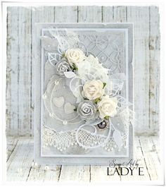 Gorgeous silver 'n white card decorated with handmade paper roses - beautiful!