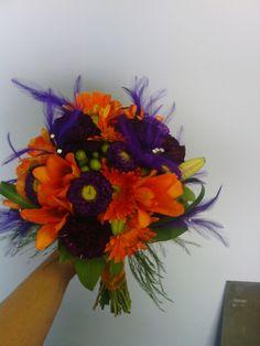 "Orange lilies, Orange Gerber Daisies, Green hypericum berries, Purple matsumotos, Deep purple carnations, salal, lily grass, tree fern and Purple ""Flutterz"" by Fitzdesign. Congrats Jessica!"