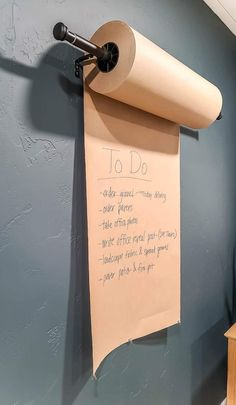 When making our home office, we needed a place to write things down, but a white board didn't seemed to fit our theme. This is when we came up this this boho DIY Kraft paper roll wall dispenser! Get all the details here! #boho #wall #dispenser Office Wall Organization, Black Curtain Rods, Wall Decor Crafts, Paper Roll Holders, Landscape Fabric, Wall Anchors, Boho Diy, Recycled Wood, Kraft Paper