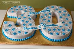 """White Block 30 #60Milestones  This cake is shaped as a number """"30"""". It is iced in white buttercream and decorated with miniature blue swirls."""