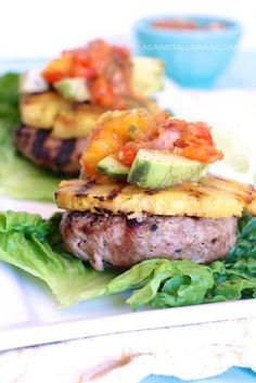 My Hawaiian Turkey Burgers are paleo and gluten free. Topped with grilled pineapple and mango salsa, these burgers are sure to be a hit at your next summer BBQ. Get the recipe here! #hawaiianturkeyburgers #paleo Primal Recipes, Real Food Recipes, Cooking Recipes, Healthy Recipes, Disney Recipes, Chickpea Recipes, Lentil Recipes, Disney Food, Cooking Tips