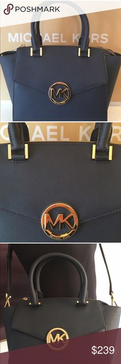 MICHAEL KORS NEW SHOULDER/ HANDLE BAG 100% AUTH MICHAEL KORS NEW WITH TAGS NEVER USED SHOULDER/ HANDBAG. STUNNING BAG AND PERFECT IN EVERY STYLISH WAY.WILL LOOK STUNNING FOR ANY OCCASION. THIS BAG IS NAVY BLUE AND MEASURES 13 INCHES WIDE AND 8.5 INCHES TALL AND IS 5. 5 INCHES DEEP. IT ALSO HAS METAL FEET ON THE BOTTOM FOR PROTECTION.  THE HANDLES HAVE A 5 INCH DROP AND IT ALSO HAS A LONG REMOVABLE AND ADJUSTABLE SHOULDER STRAP Michael Kors Bags Shoulder Bags