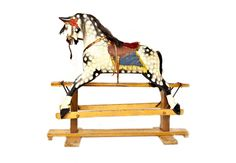 English Rocking Horse c. 1920's A charming 1920's English painted rocking horse, with horsehair mane and tail, and with original paint. http://www.charlieford.com