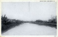 Bayou Teche at New Iberia, ca. 1920; note railroad track on west (left) bank.  Source: Postcard image, Shane K. Bernard Collection.