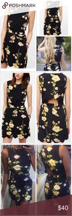 Pretty Scalloped Hem Open Back Floral Dress Bycorpus by Urban Outfitters. Great condition mini dress. Stretchy elastic scrunch waist allows for easy fitting. Tiered overlapping panels expose the back. Mini length. Black with a yellow floral pattern. Sleeveless. If you love these brands:  zara  anthropologie  asos  reformation  theory  for love and lemons You will love this!  Urban Outfitters Dresses