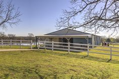 8-stall horse barn overlooks Lake Eufaula in Eastern OKlahoma.  The stable is now used as a shop.