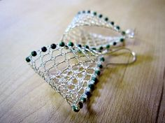 Beautiful handmade metal lace earrings.