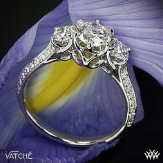 "Engagement Ring by Vatche. Elegance is redefined with this magnificent ""Swan"" 3 Stone Engagement Ring. The graceful lines twist and swirl to create an extraordinary sanctuary for your diamonds, which will allow for maximum exposure and total security. The sides of the shank sparkle with 36 Round Brilliant Diamond Melee."