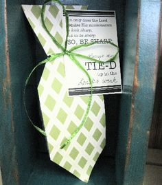 """Designed like a tie, this bag is full of fun Frooties for your missionary with a tag to remind them what they should be doing.  It reads:  """"Not only does the Lord require His missionaries to look sharp, but to be sharp.  So, be sharp:  Always stay tie-d up in the Lord's work.""""  Such a fun bag to remind your missionary to stay all """"tie-d"""" up in the Lord's work!  Scrapbook paper for tie & Frooties may vary"""