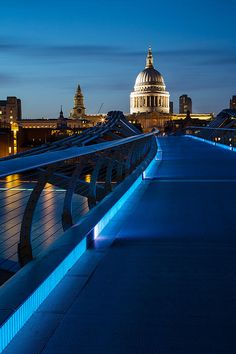 The Millennium Bridge Lights Glow Blue And Lead The Eye To The Illuminated Dome Of St Paul's Cathedral | London | England | Photo By Adam Pender