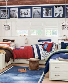 Love the tall wainscoating with a strip of navy blue at the top.  The picture galler on the blue works too.