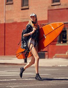Channeling her inner surfer girl, model Nastya Sten takes the beach to the…