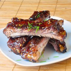 These honey garlic sticky ribs are slowly cooked to tender perfection & glazed with layers of sweet, sticky, garlic glaze; the ribs you can't stop eating!