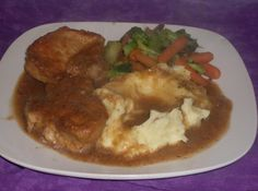 Obie Green's Smothered Pork Chops #chops #onions #smothered #pork chops #pork #justapinchrecipes Pork Chop Recipes, Meat Recipes, Cooking Recipes, Pork Dishes, Tasty Dishes, Pork Chops Bone In, Pork Ham, Dinner Entrees, Kitchens