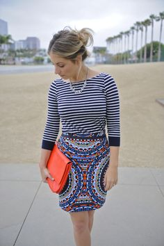stripes and pattern combo with the pop of orange from cupcakes and cashmere