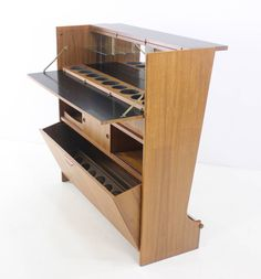 Danish Modern Teak Bar Designed by Johannes Andersen | From a unique collection of antique and modern dry bars at https://www.1stdibs.com/furniture/storage-case-pieces/dry-bars/