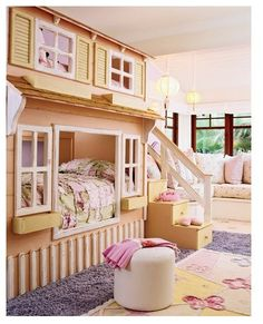 A bed? A loft? A life-size doll house?   All of the above. (Plus built-in stair storage!) for my little girls :)