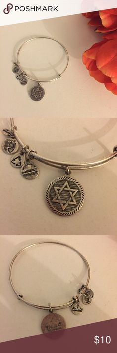 Alex & Ani Star of David Bangle Alex & Ani Star of David bangle! Great to wear alone or stacked with other bangles! Some tarnishing and wear on the bangle and charms as shown in pictures. Alex & Ani Jewelry Bracelets