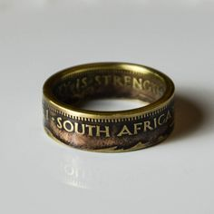 Handcrafted #CoinRing from #TheRingTree made from a #SouthAfrican Half Cent coin.