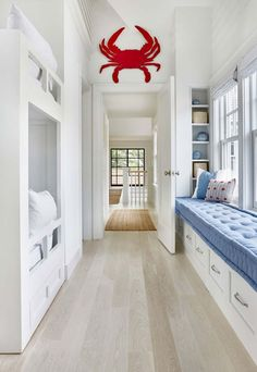 Beachy bunk room - wide hallway with bench seat and storage drawers underneath.