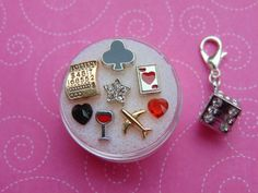 Going to Vegas 9 Piece Floating Charm Set. Includes Lottery Ticket, Deck of Cards and Plane. Lucky Dice Included. Free Gift with Purchase.