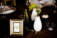 A mix of mini & vintage vases on reception tables