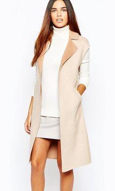 Sleeveless Wool Coat by Warehouse. Coat by Warehouse, Wool-rich fabric, Notch lapel collar, Open front, Side pockets, Side splits, Regular fit - true to...