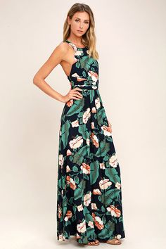 You'll be tempted to escape to a secret getaway in the Temptation Island Navy Blue Floral Print Maxi Dress! Navy blue woven rayon, with a green, orange, and cream floral print, flows from a high rounded neckline, to a sleeveless bodice with thick straps that crisscross at back. Full and flowy maxi skirt. Hidden back zipper.