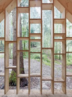 This see-through timber cabin provides shelter for a forest kindergarten.